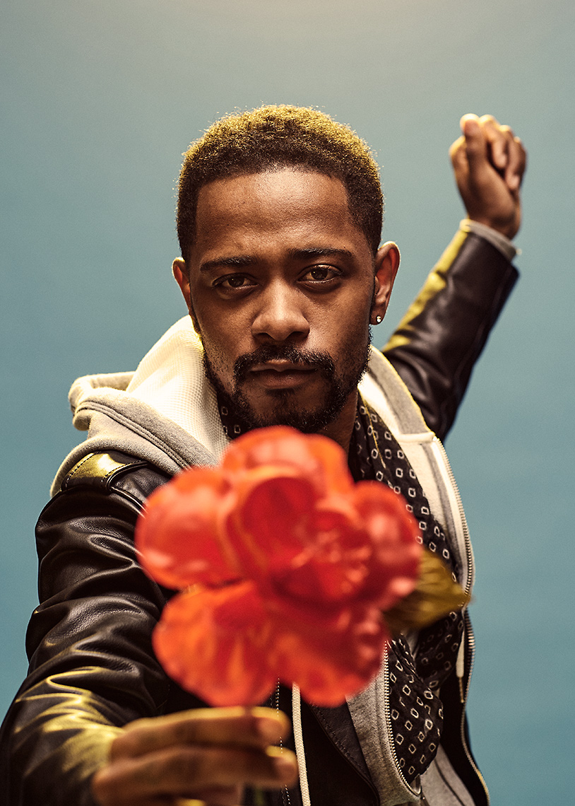 Lakeith Stanfield holding a flower