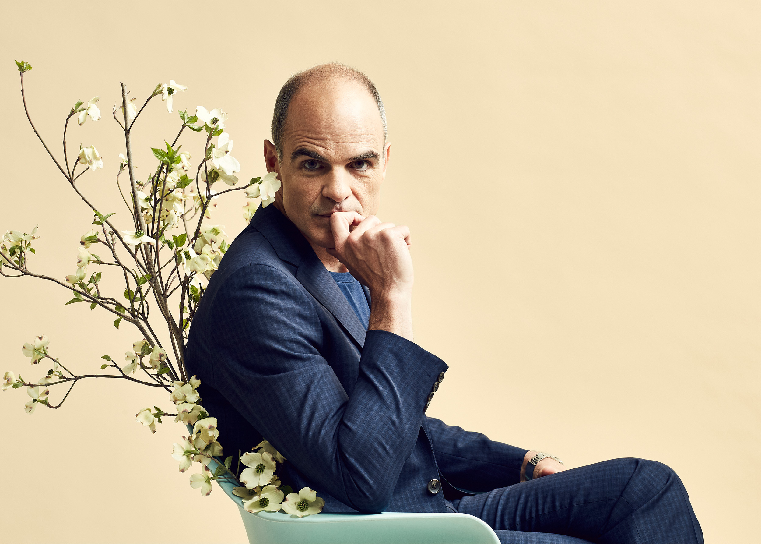 seated portrait of actor Michael Kelly