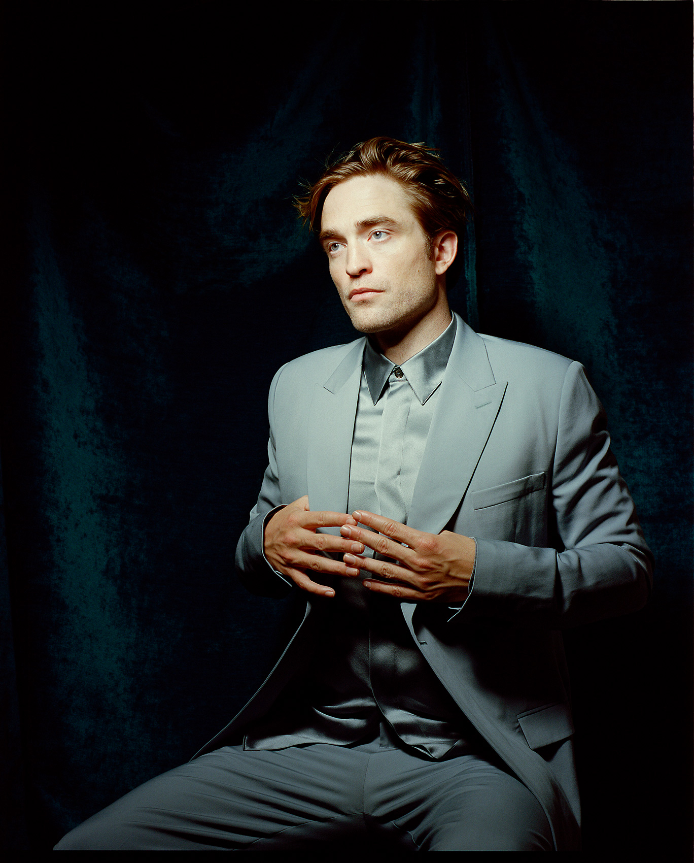 Rob Pattinson portrait against velvet